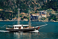 Ship passing Monastery on mount Athos Royalty Free Stock Image