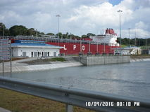 Ship passing through new locks in Panama big tanker royalty free stock image