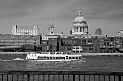 Ship passing St. Paul Cathedral in London Stock Images