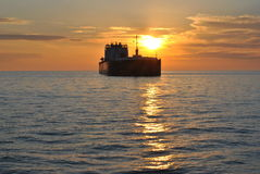Ship passing throw. Sitting watching the ship pass the sun royalty free stock photo