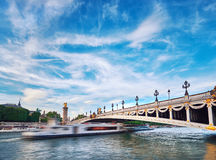 Ship passing under Alexandre III Bridge in Paris Royalty Free Stock Photo