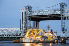 Ship passing under bascule bridge Royalty Free Stock Images