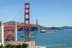 Ship passing under the Golden Gate Bridge. The Golden Gate Bridge is a suspension bridge spanning the Golden Gate strait, the mile-wide, three-mile-long channel Royalty Free Stock Images
