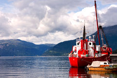 Ship at the pier. Ship at the pier on the background of mountains Stock Photo