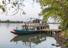 Ship at pier. Primitive ship at pier waits on tourists in Gambia . West Africa Royalty Free Stock Images