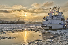 A ship at the pier blocked by ice Stock Photos