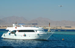 Ship and plane. (Red sea Stock Photography