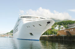 Ship at port. A cruise ship in port at a small fishing town Royalty Free Stock Photos