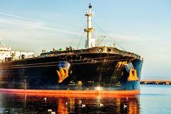 Ship in port. A bow of a tanker ship with anchor Stock Image
