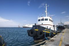 Ship in the port of Heraklion. A boat on the water on the island of Crete stock image