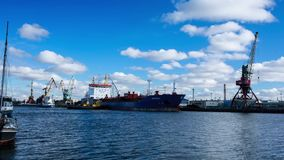 Ship in a port of Kaliningrad at sunny day, time lapse stock video