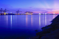 Ship and port at night Stock Images