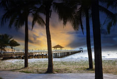 Ship port piers on sea beach against beautiful dusky sky and coc Royalty Free Stock Photos