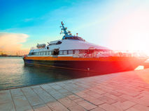 Ship at the port in the setting sun Royalty Free Stock Images