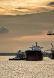 Ship at port during sunset. Bulk carrier and general cargo ship berthing at port during sunset stock photo