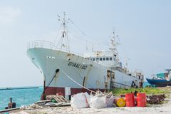 Ship in the port at the tropical island Maamigili. In Maldives royalty free stock images