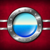 Ship porthole with seascape Stock Images