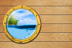 Ship porthole with tropical landscape Stock Photo