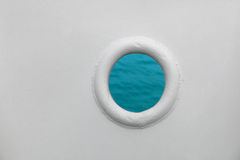 Ship porthole on white wall Royalty Free Stock Image