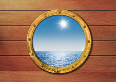 Ship porthole on wooden wall Stock Images