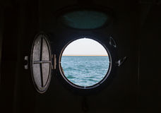 Ship porthole on wooden wall Stock Photos