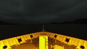 A Ship Prepares to Depart Stokmarknes, Norway. A timelapse recording looking over the bow of a ship as it prepares to depart the town of Stokmarknes, Norway stock footage