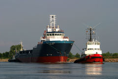 Ship pulled by a barge. To see Stock Photography
