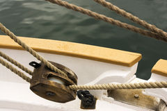 Ship pulley. Wooden boat pulley with ropes Stock Images