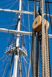 Ship pulley and rope. Pulley on an sailship on a sunny day Stock Image