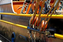 Ship Pulleys and Ropes. Side view of sailing ship with ropes and pulleys Stock Image