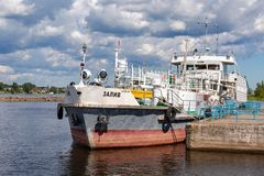 Ship is at the quay wall of the river port in sunny day Royalty Free Stock Images