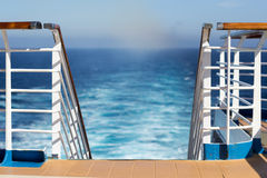 Ship railing with wake in background Stock Image