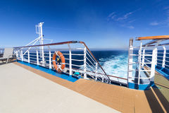Ship railing with wake in background Royalty Free Stock Photo