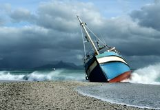Ship that ran ashore in storm stock photography