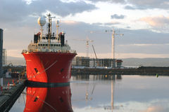 Ship Reflected. Leith Harbour, Edinburgh, Ship reflected in the harbour waters at sunset Royalty Free Stock Images