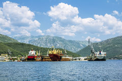 Ship-repair docks with the ships in the Bay of Kotor. view from Royalty Free Stock Photography