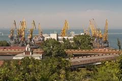 Ship-repair yard. Industrial zone of sea cargo port with grain dryers, containers, cranes and storehouses photo Stock Photography