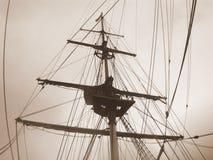 Ship rigging in sepia. Uniform sky Stock Image