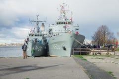 Ship at River Daugava, port and buildings. Urban city view. Water and nature. Travel photo 18 november 2018. stock photos