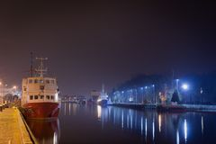 Kolobrzeg, Poland - 03 05 2016: Ship on the river at night. royalty free stock images
