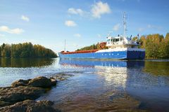 Ship and rocks, Baltic sea, Saima channel Royalty Free Stock Photo
