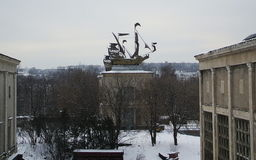Ship on the roof. Sculpture of a sailing ship on the roof of the building in the winter Royalty Free Stock Photos