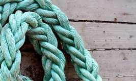 Ship rope. Old texture of wooden boards with green ship rope Royalty Free Stock Photography