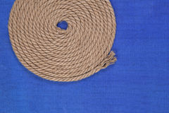 Ship rope on blue background, top view Stock Photo