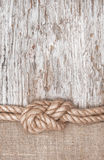 Ship rope, burlap and wood background stock photo