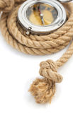 Ship rope and compass isolated on white Royalty Free Stock Photography