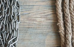 Ship rope and rusty iron chain on a old background. Copy spase, Stock Photo