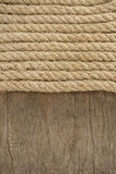 Ship rope and old wood background Royalty Free Stock Photography