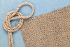 Ship rope on old wooden texture background Stock Photos