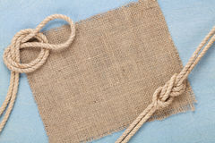 Ship rope on old wooden texture background Stock Images